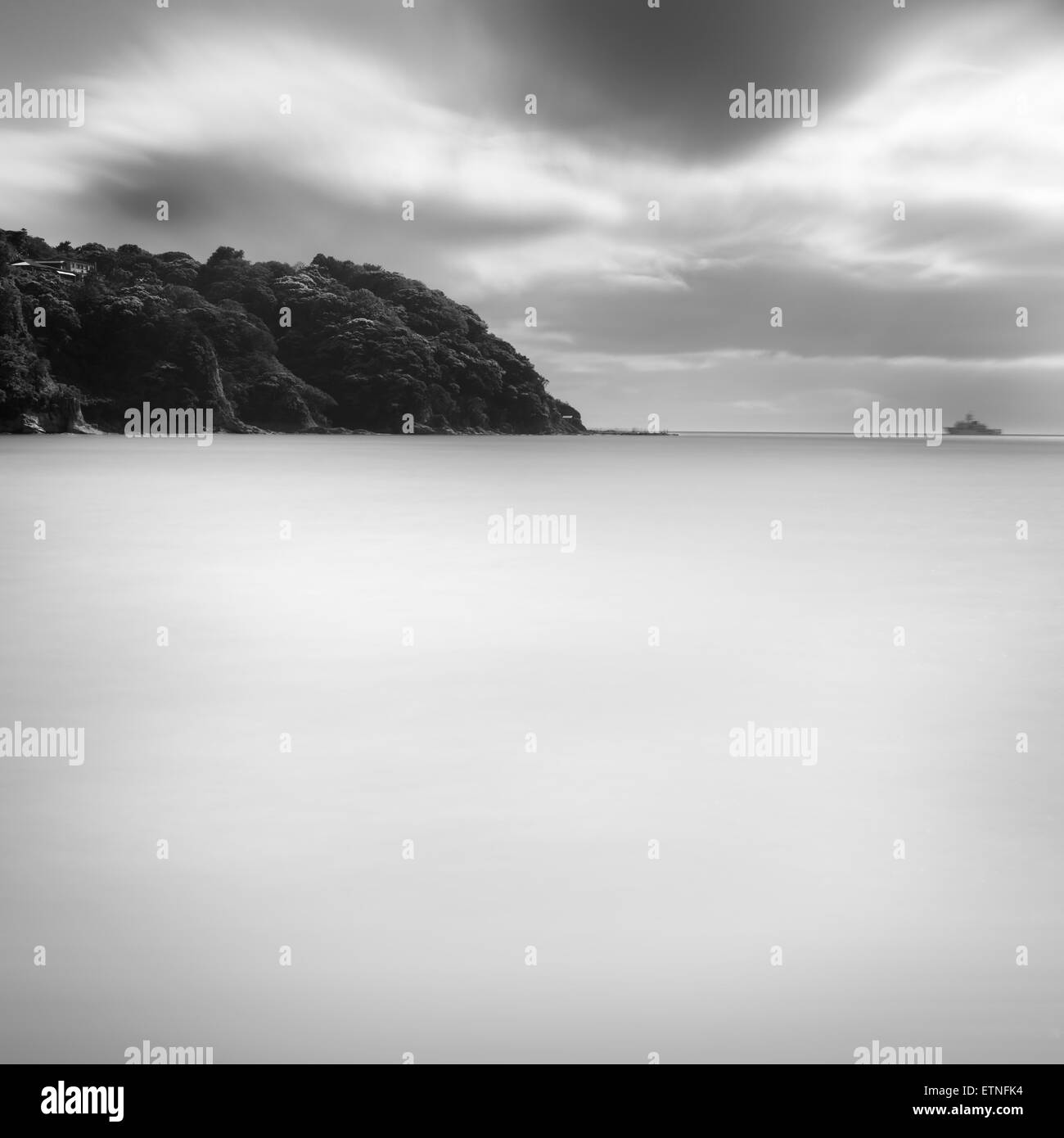 Island in Enoshima and silky water under clouded sky, Kanagawa Prefecture, Japan - Stock Image