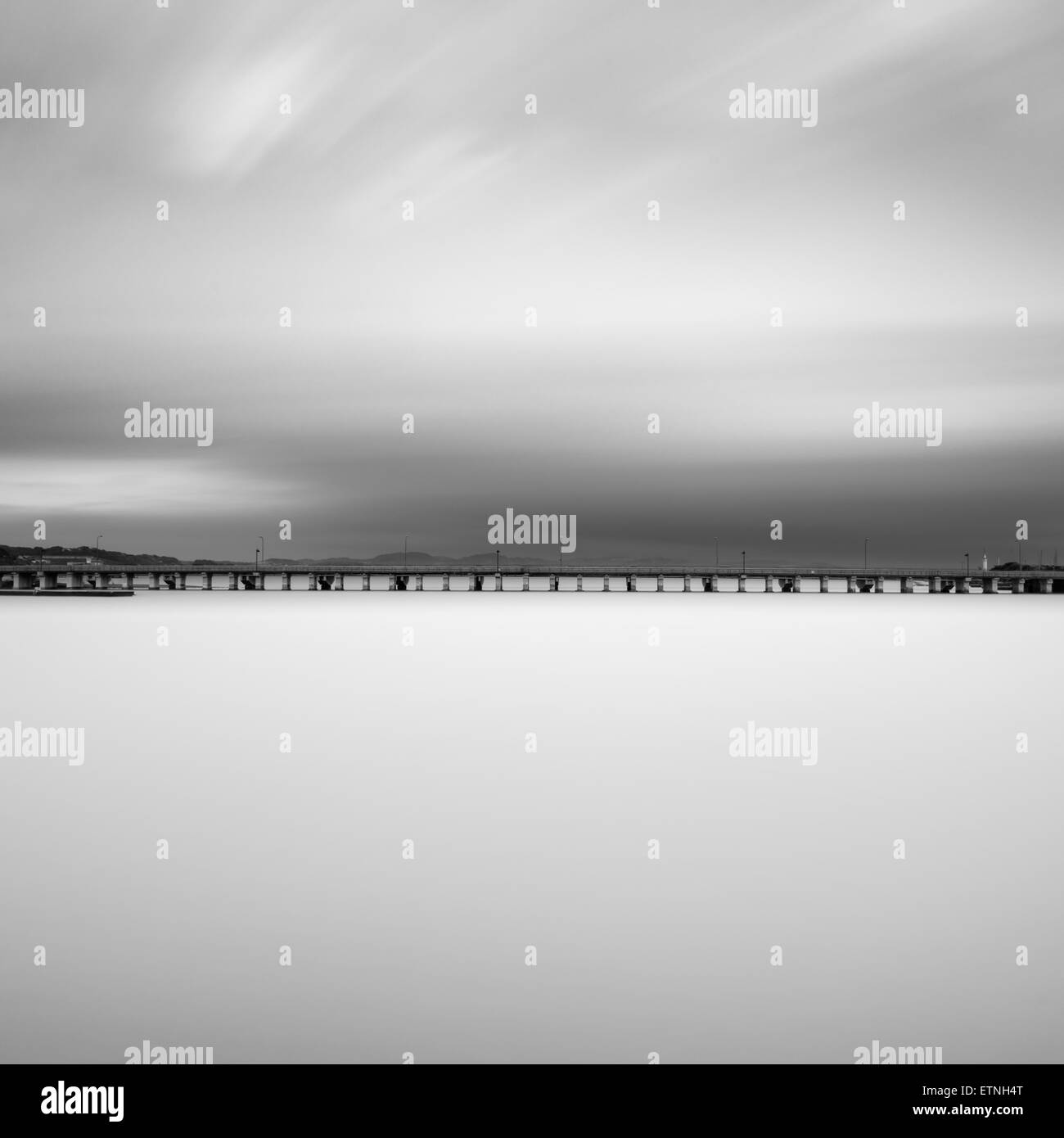Road over the sea and clouded sky, Kanagawa Prefecture, Japan - Stock Image