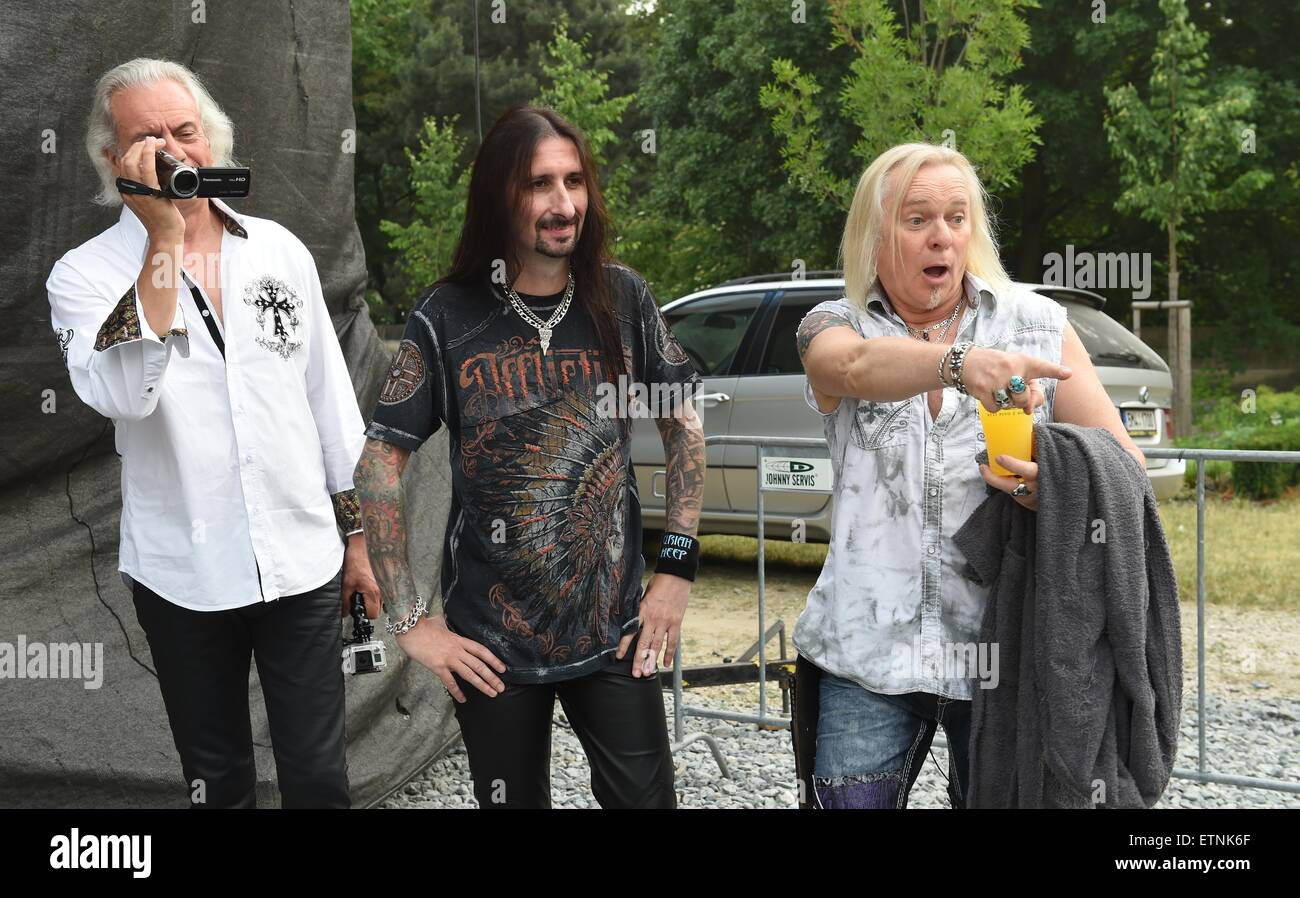 Phil Lanzon, Davey Rimmer and Bernie Shaw, from left, of British heavy metal group Uriah Heep pose before their - Stock Image