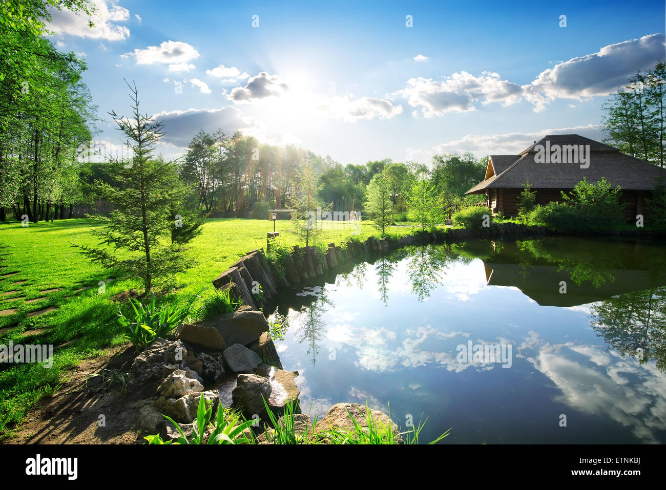 Wooden bathhouse near lake in the evening - Stock Image