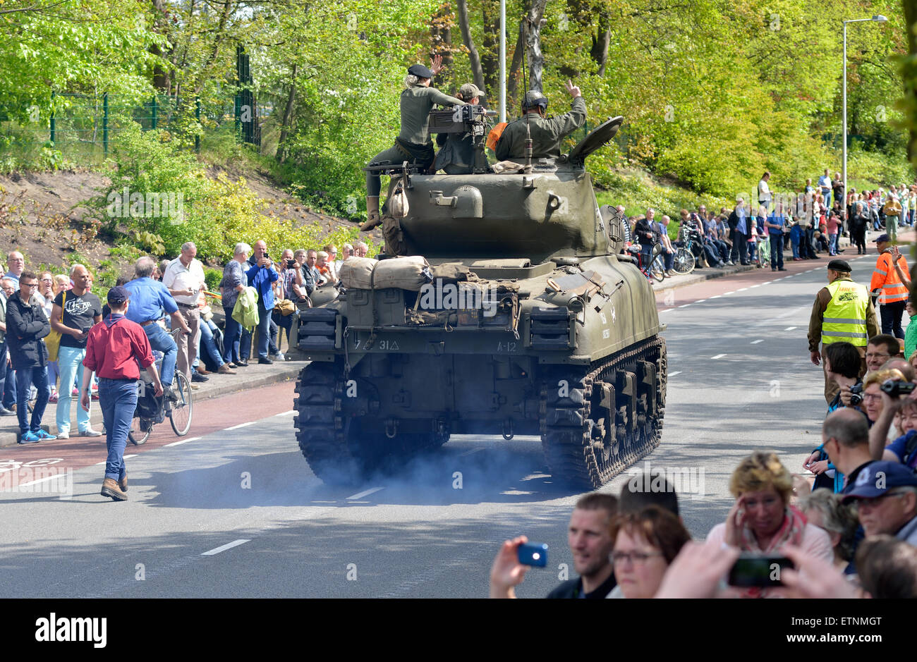 Remembrance parade with a Sherman tank on the fith of may, the day that The Netherlands remembers the liberation - Stock Image