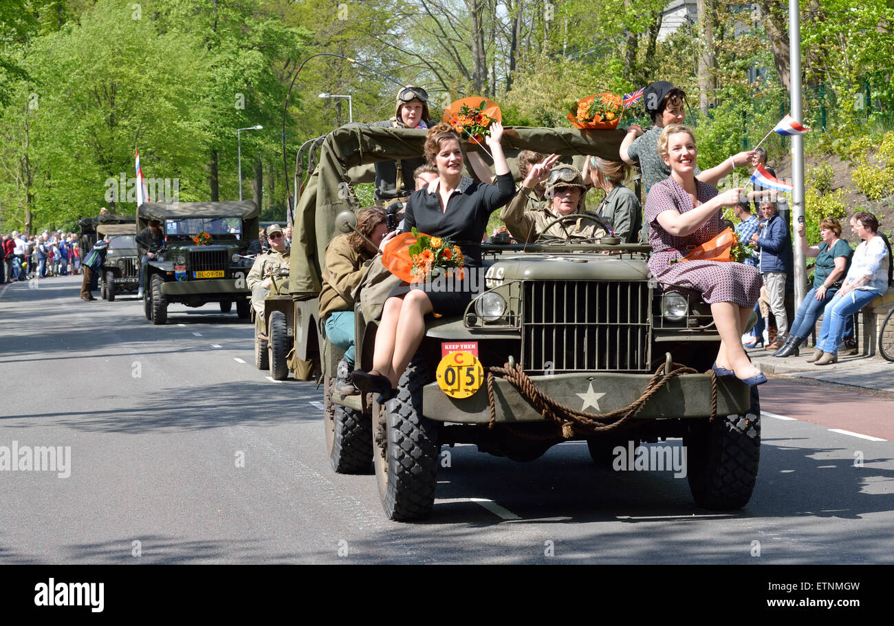 Remembrance parade with a jeep on the fith of may, the day that The Netherlands remembers the liberation of the - Stock Image