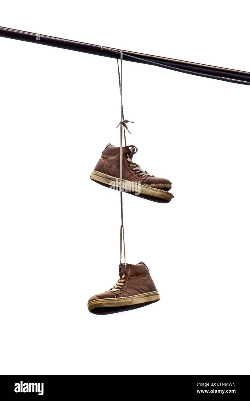 Old Sneakers Hanging On Line Stock Photos & Old Sneakers Hanging On ...