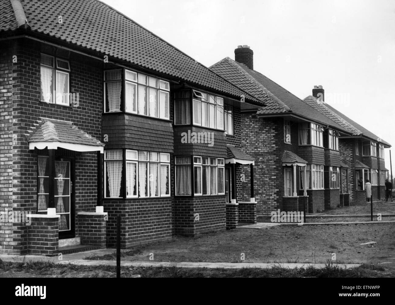 These houses are some of those built as the result of 15 months work at Leeside Avenue, Kirkby. 17th June 1956. - Stock Image