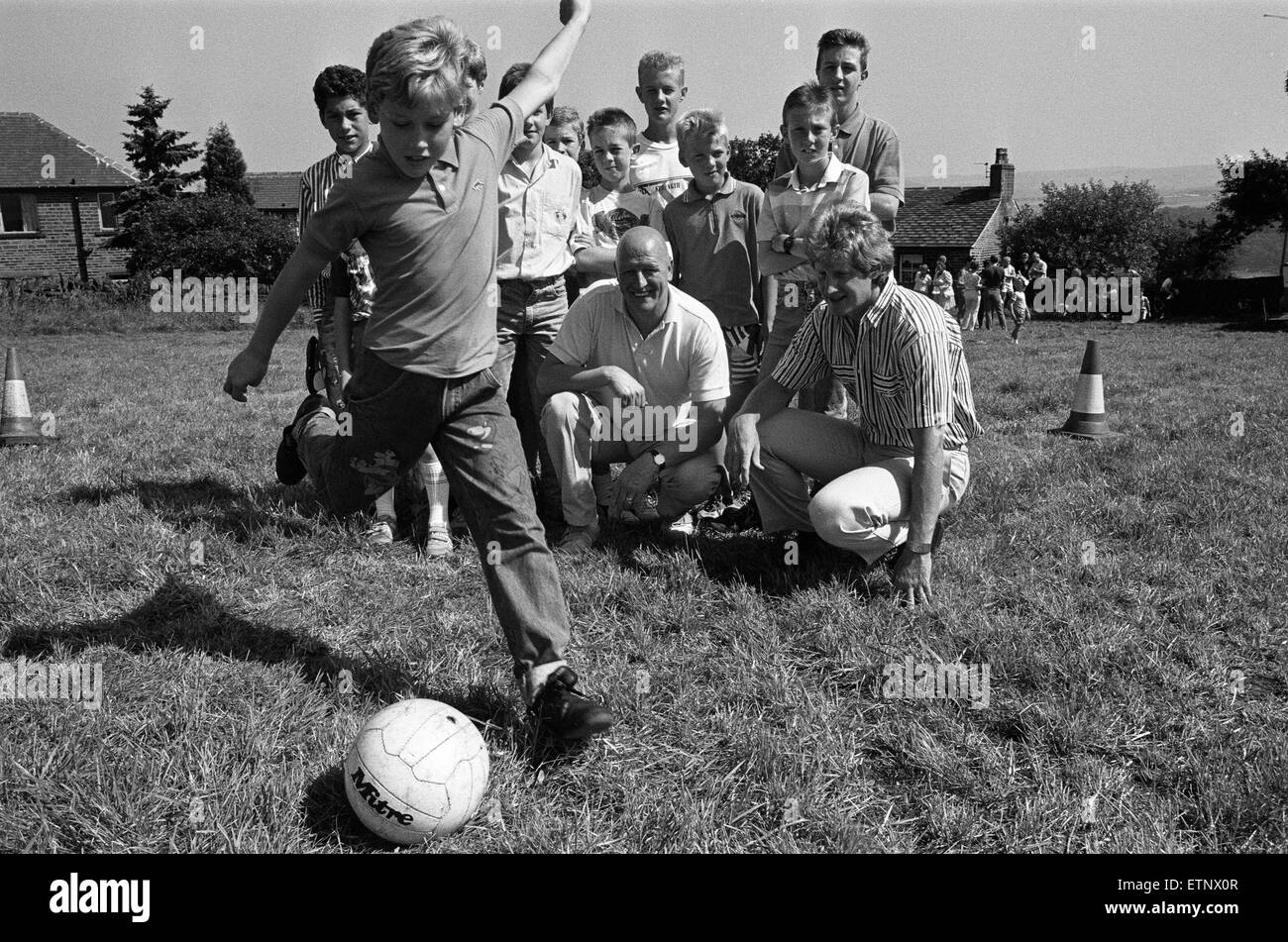 Best foot forward... Young Jeremy Illingworth has a go at the penalty competition during the annual pig roast and - Stock Image