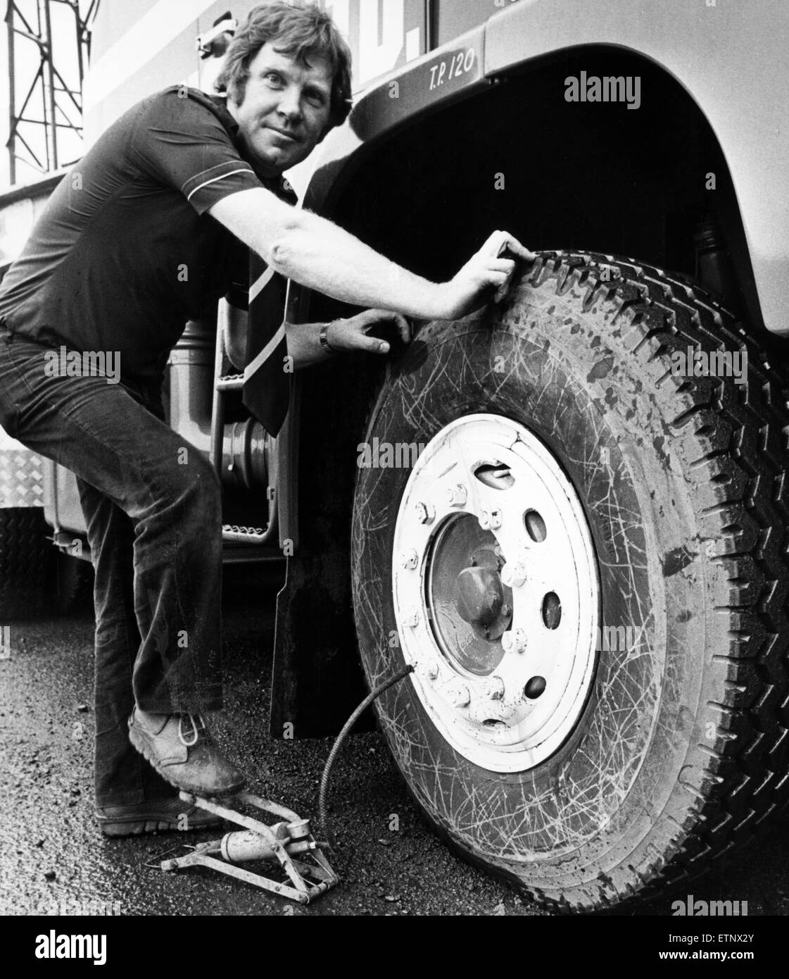 Jon Bainbridge, workshop manager,  at A V Dawson Ltd. Haulage Company. checks one of the this rigs tyres, Middlesbrough, - Stock Image