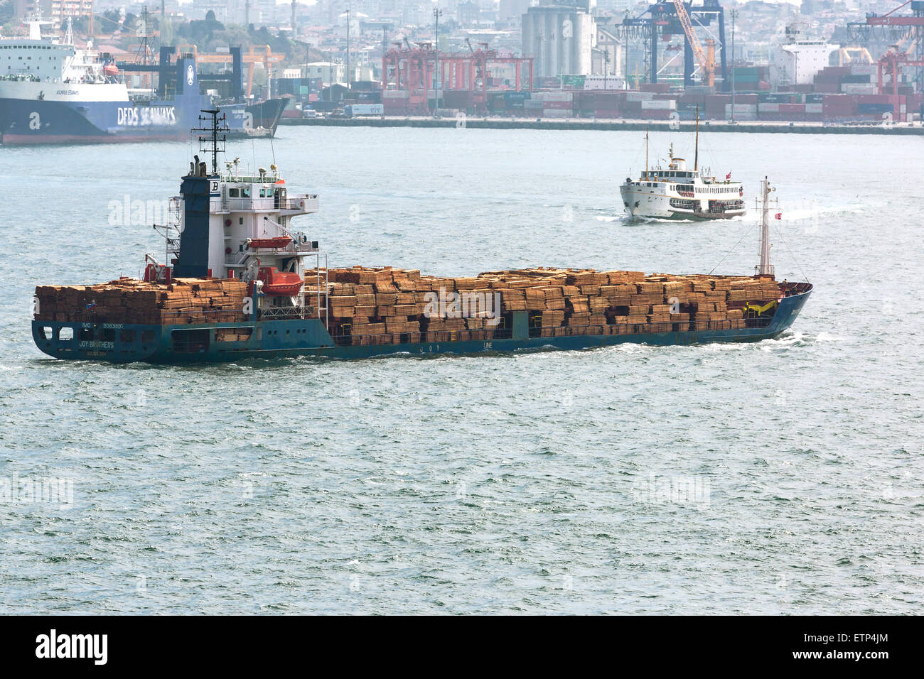 Heavily laden cargo vessel carrying timber. Port of Istanbul Turkey - Stock Image