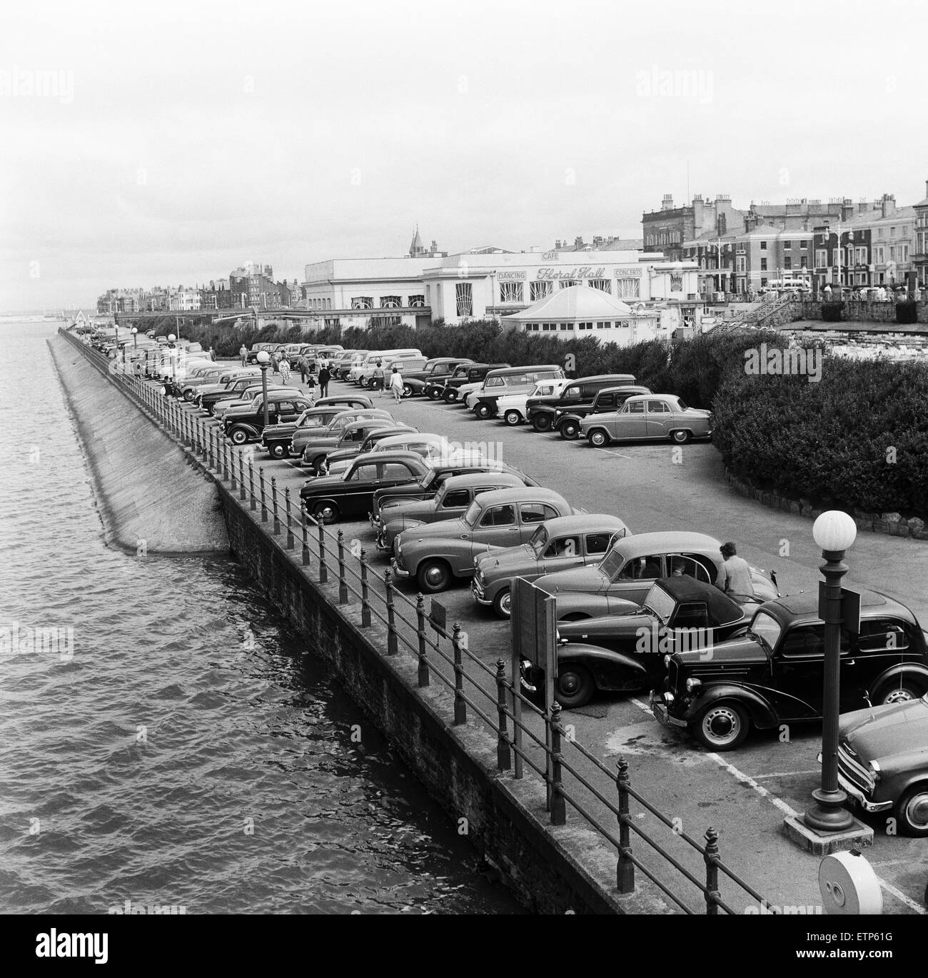 Cars parked along the sea front at Southport, Merseyside. 5th August 1959. - Stock Image