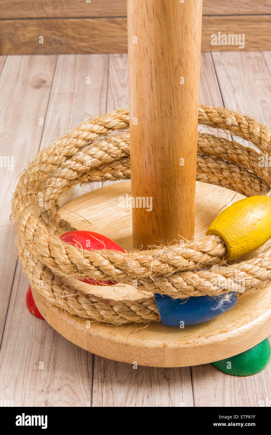 Ring Toss Game on Wood Background - Stock Image