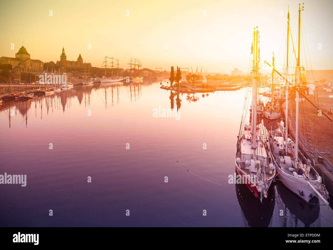 Beautiful sunrise over harbor, waterfront in Szczecin, Poland. - Stock Image