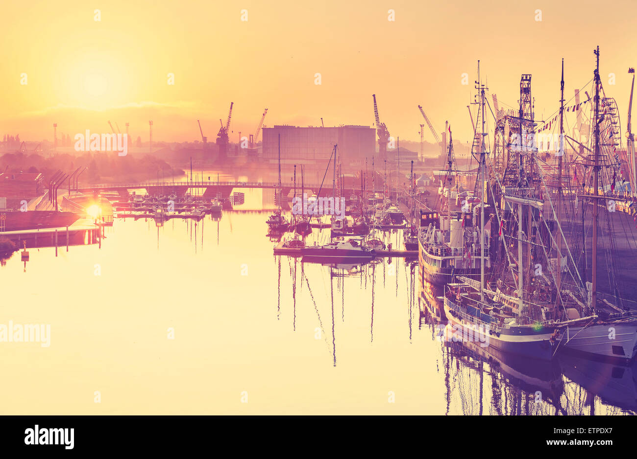Vintage toned golden sunrise over harbor, waterfront in Szczecin, Poland. - Stock Image