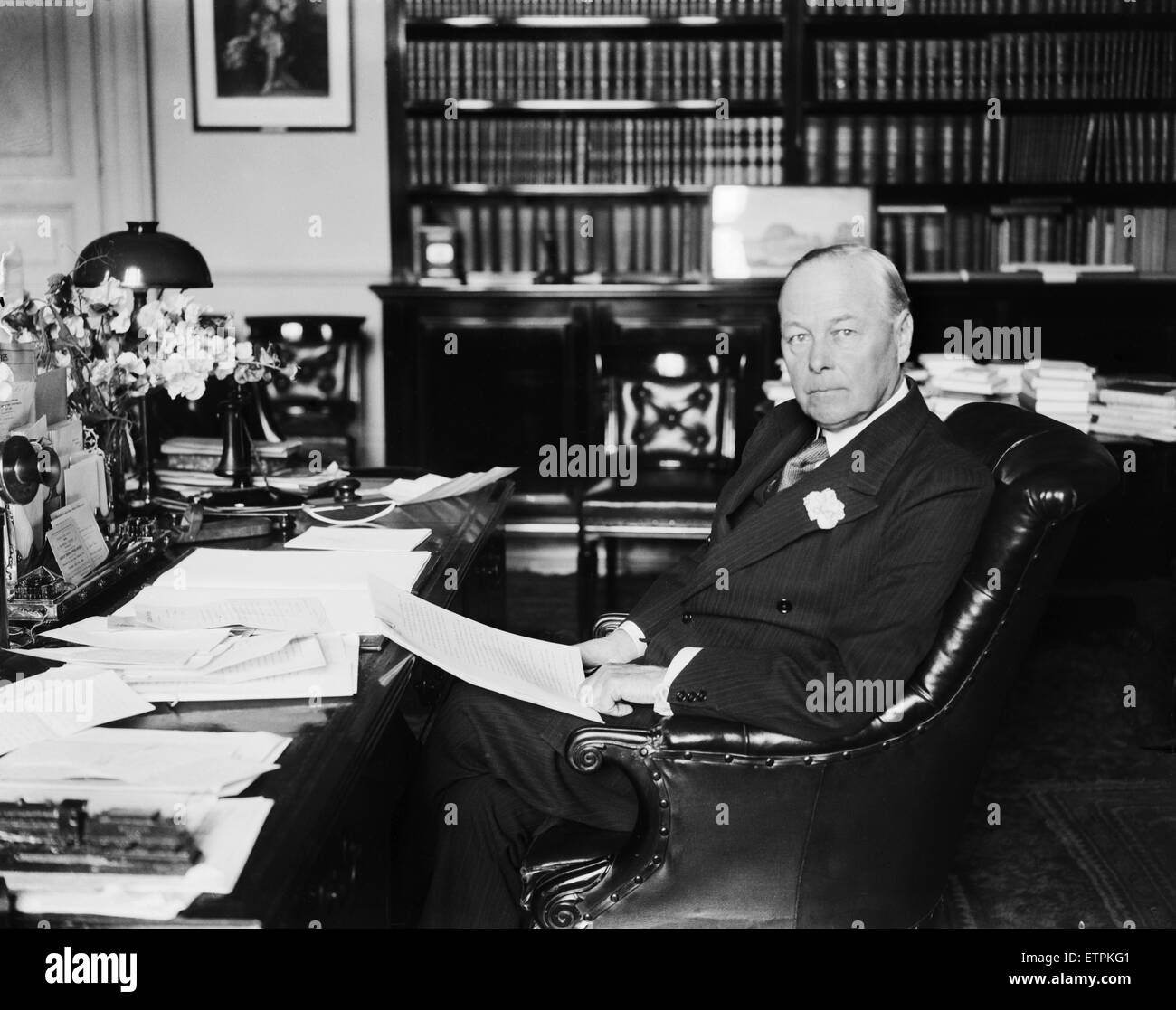 British Home Secretary Sir William Joynson-Hicks sitting at his desk in his office 14th July 1928. - Stock Image