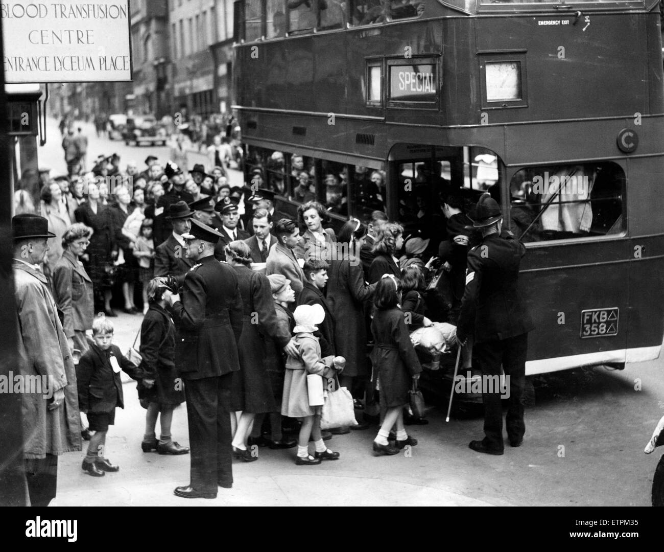 Flashback to the dark days of 1939, as Liverpool children board a bus to take them to safety. 1st September 1939. - Stock Image