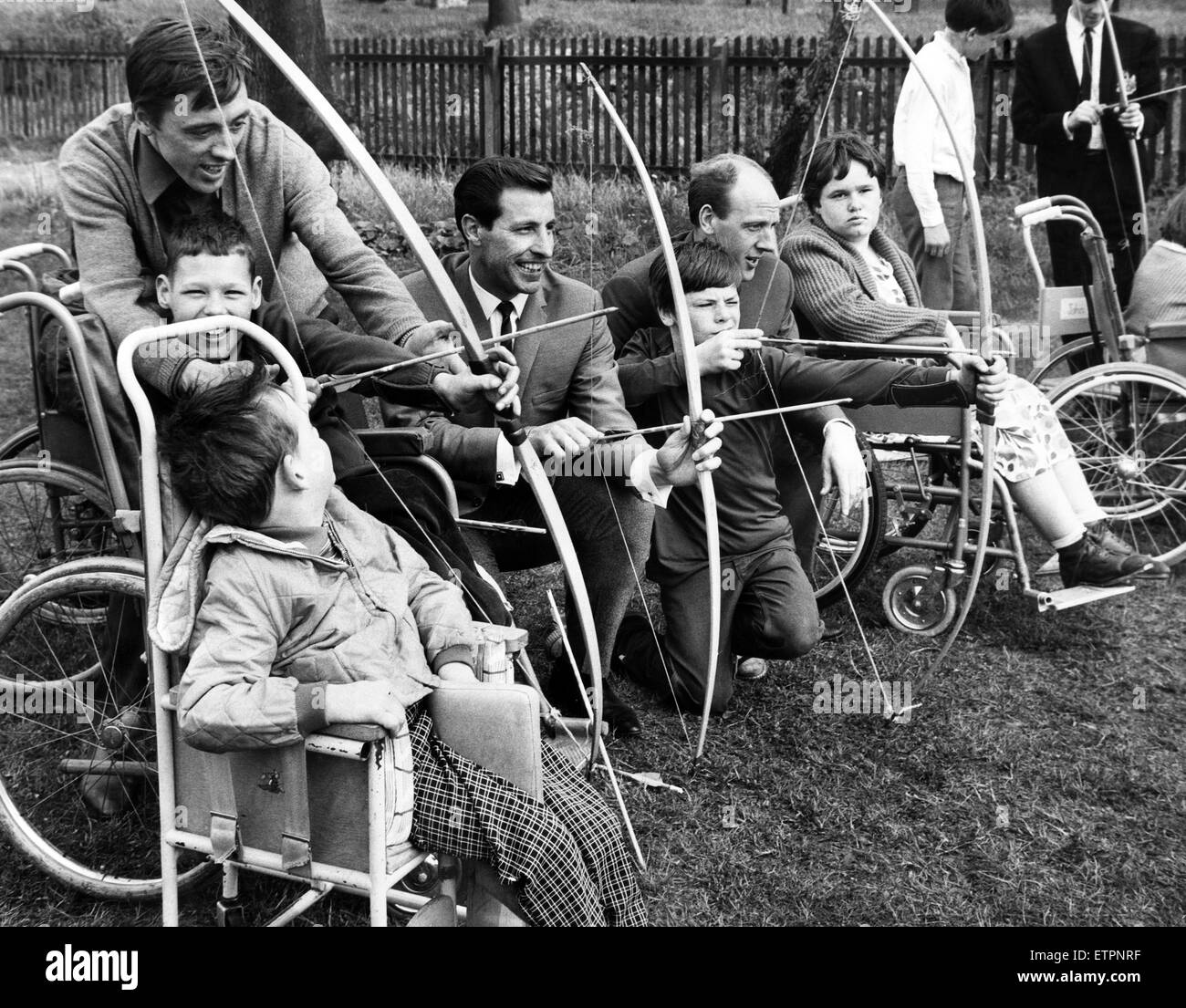 Newcastle United footballers, Tommy Knox, Ron McGarry, Jim Iley and Ollie Burton join in an archery contest with Stock Photo