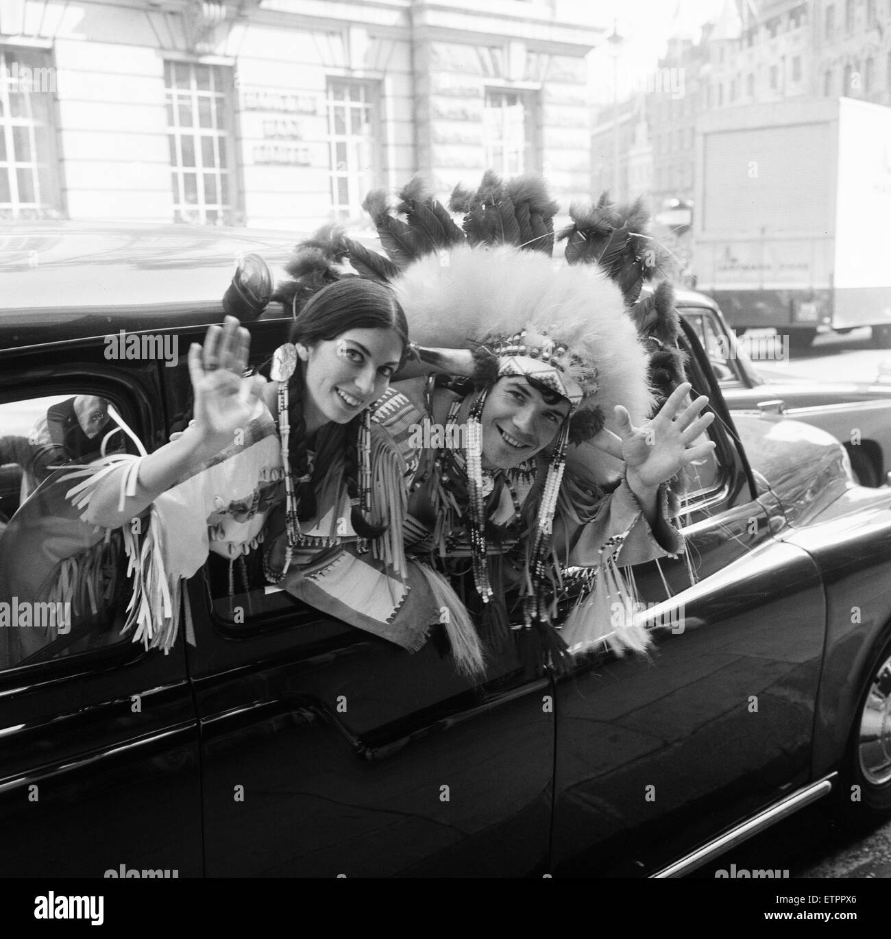 Couple of actors dressed as an Indian Chief and his Squaw, pictured leaving New Zealand House after press conference, - Stock Image