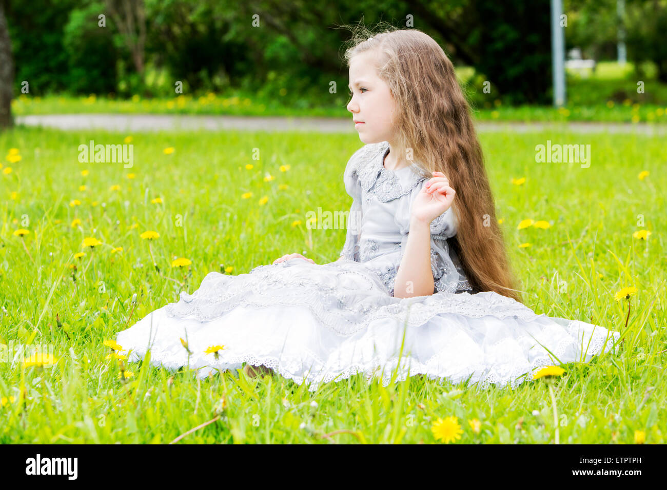 Playful princess is looking directly at someone - Stock Image