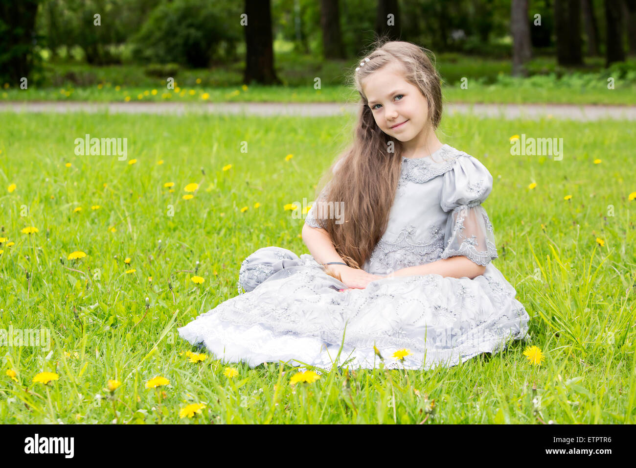 Cute girl is shy posing first time - Stock Image