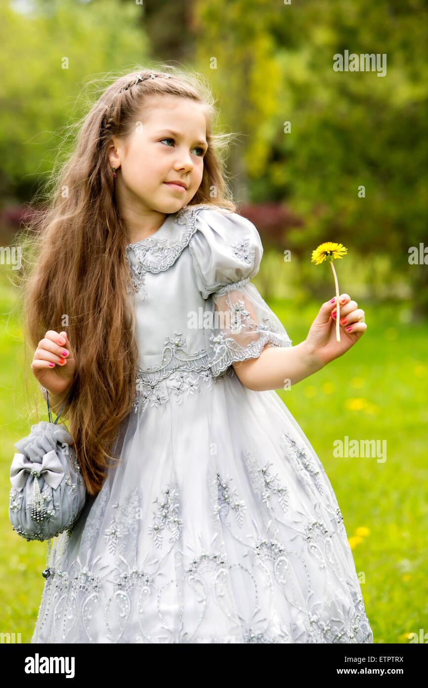 Sweet child posing like a frightened princess - Stock Image