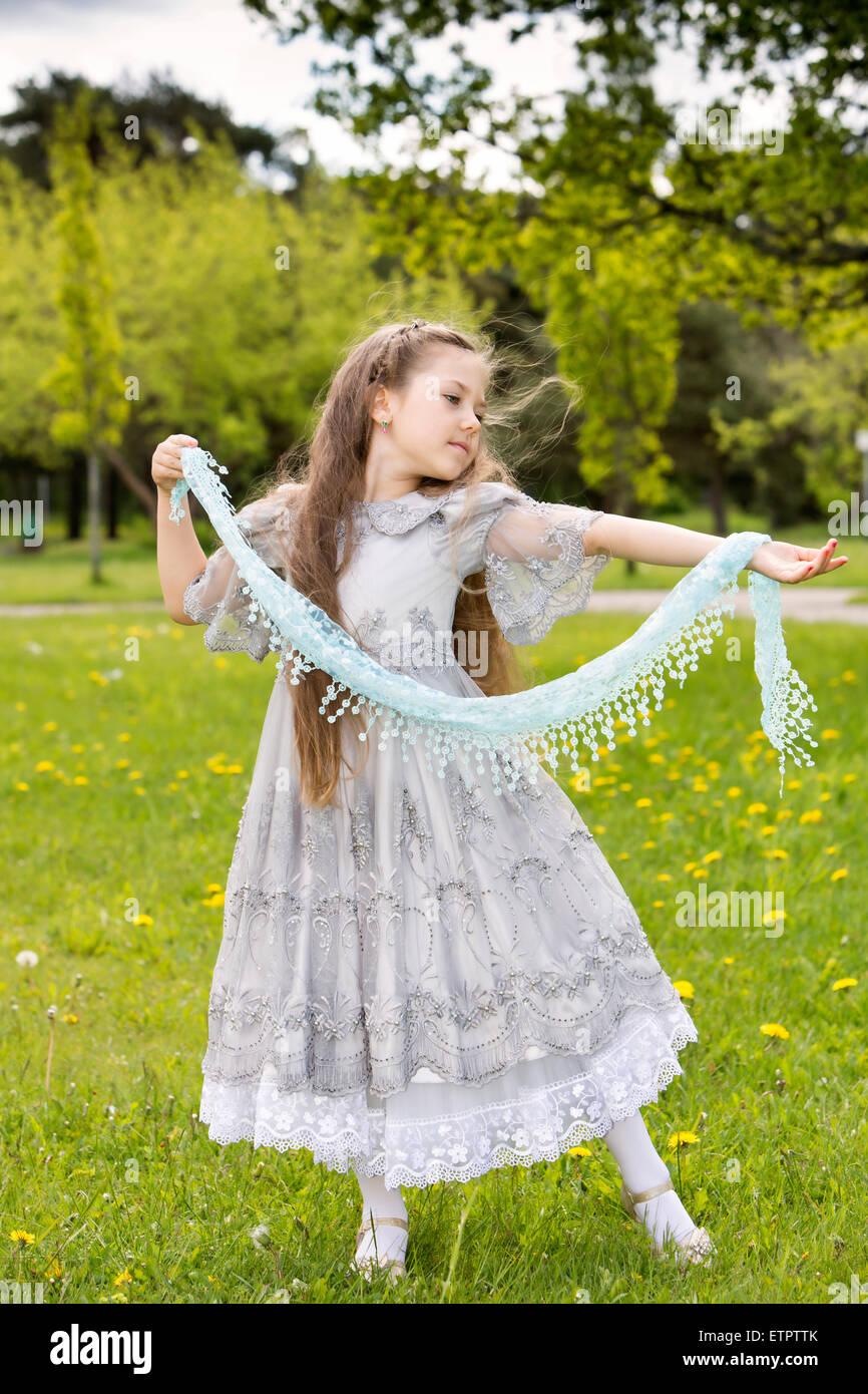 Aristocratic girl in princess dress starts dances - Stock Image
