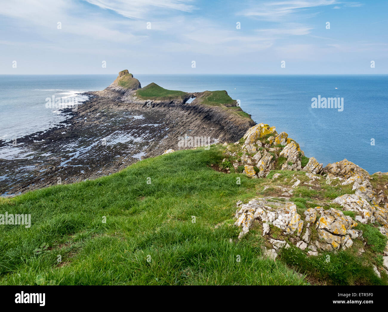 View along the outer Head of Worm's Head on the Gower Peninsula, Wales showing the Devil's Bridge - Stock Image