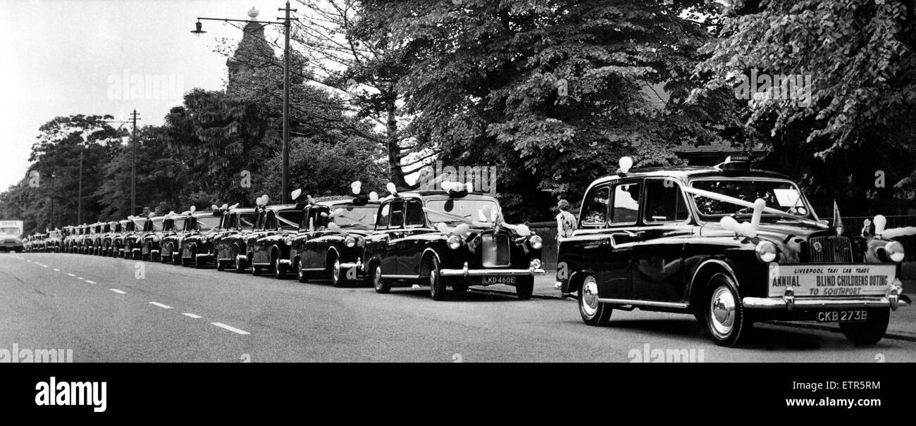Liverpool taxis wait to take blind children to Southport. Merseyside, 14th September 1972. - Stock Image
