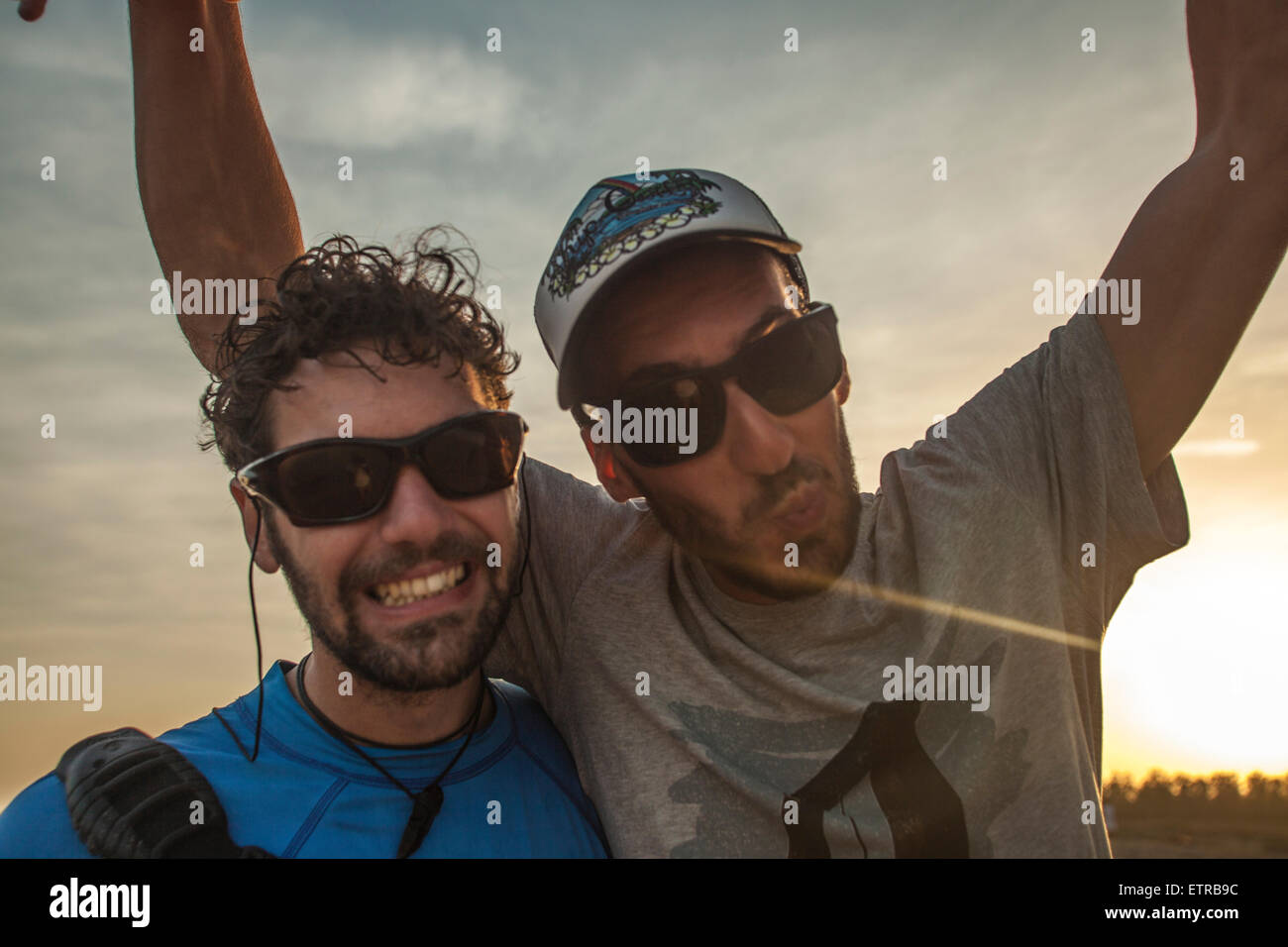 Lifestyle, non urban scene, male, young, men, sunglass, observing, facing sunlight, hat, T-shirt, Generation Y - Stock Image