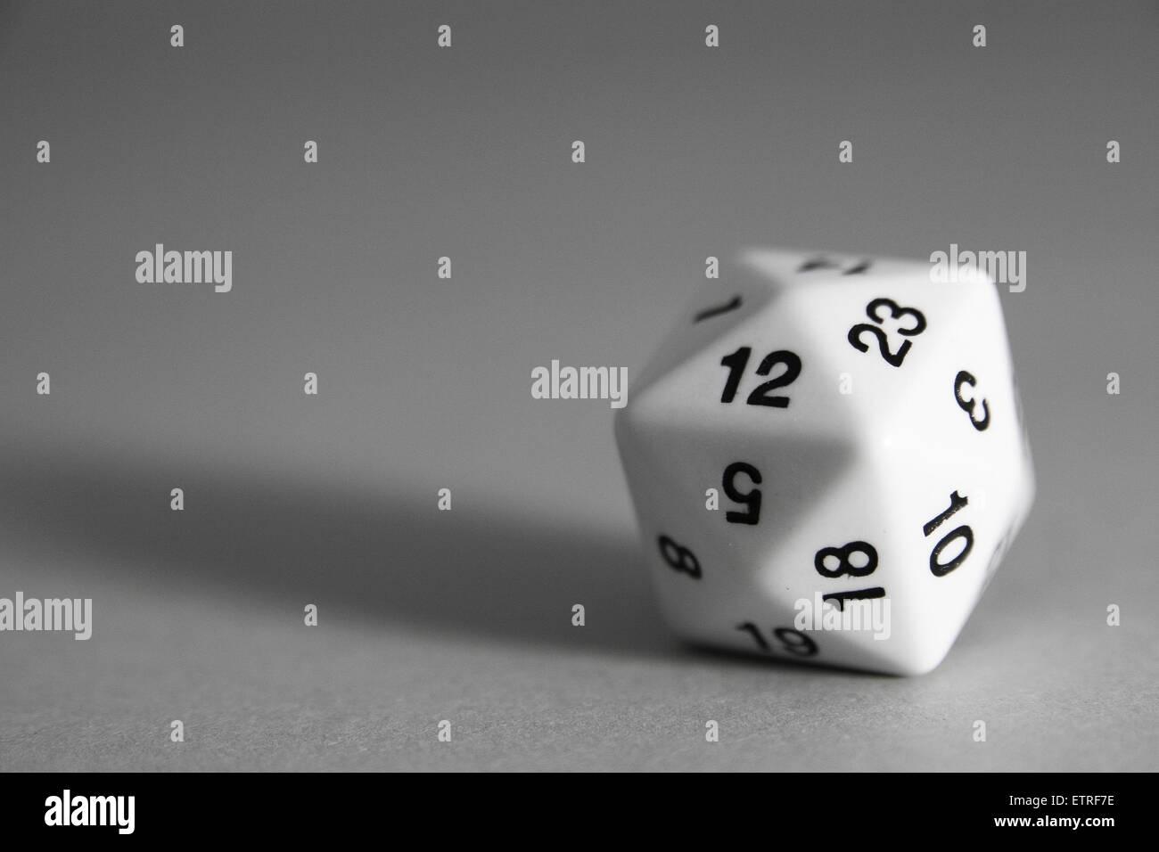 A white Tetrakis hexahedron die on grey background - Stock Image