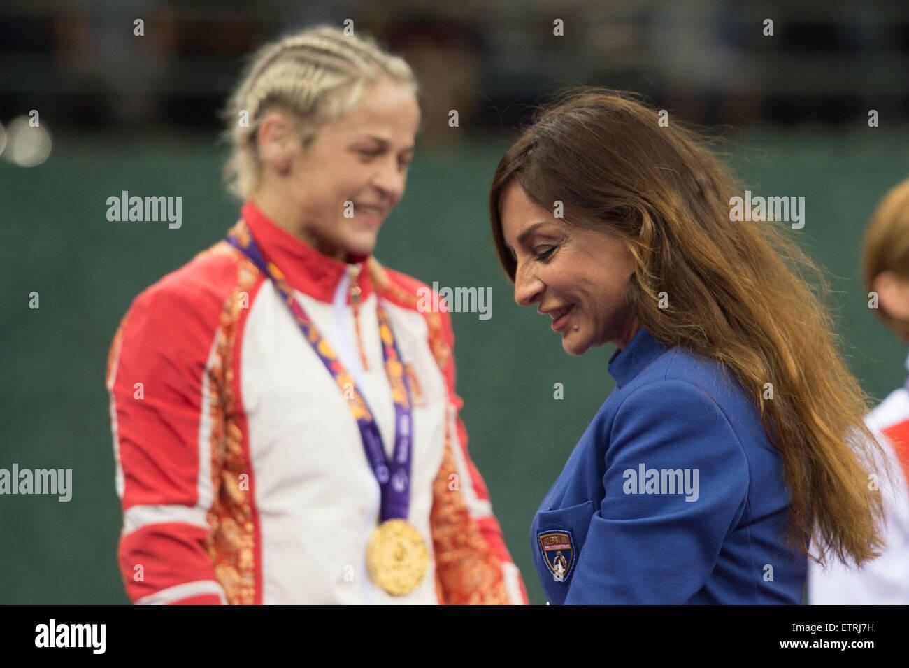 Mehriban Aliyeva (R), wife of President Ilham Aliyev, takes part in asherbaijanien gold medal winner Mariya Stadnyk's - Stock Image