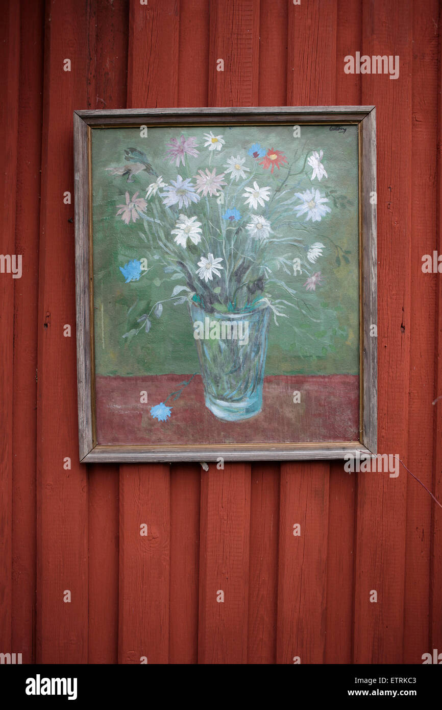 Painting on red wooden wall, Sweden, Dalarna, countryside, summer, - Stock Image