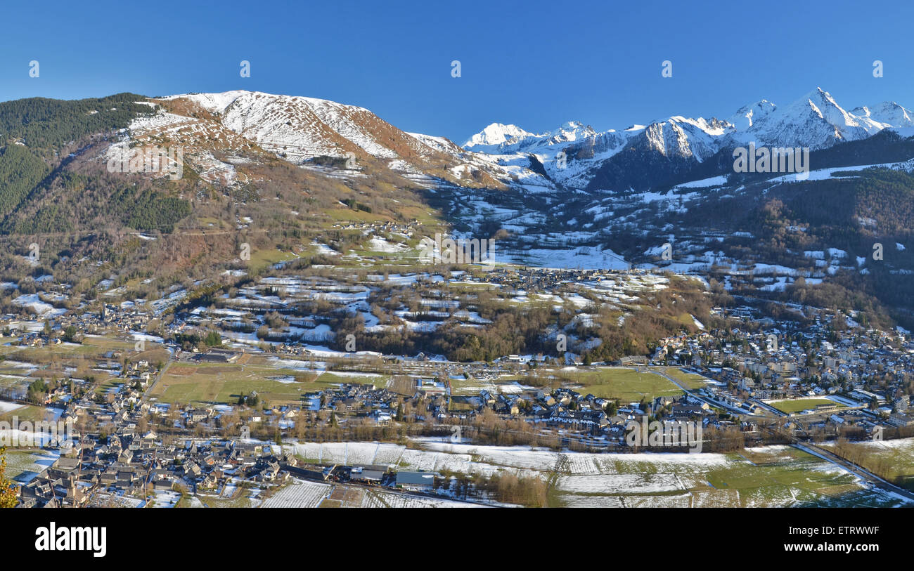 Panorama of Aure Valley in Hautes Pyrenees in winter, with Saint-Lary-Soulan village at right, Vignec in left center, Stock Photo