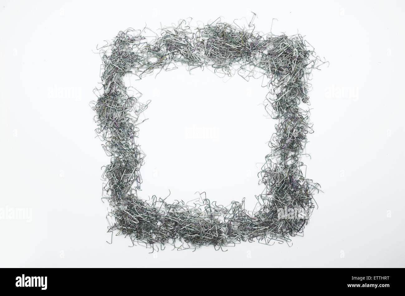Used Staple Needle In Shape Of Square Rectangular Frame Stock Photo