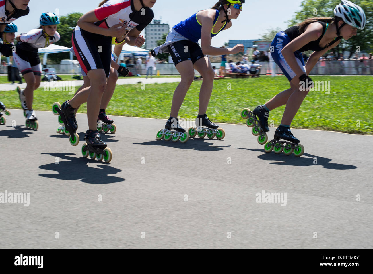 Young in-line skaters in speed skates in motion during competitions Stock Photo