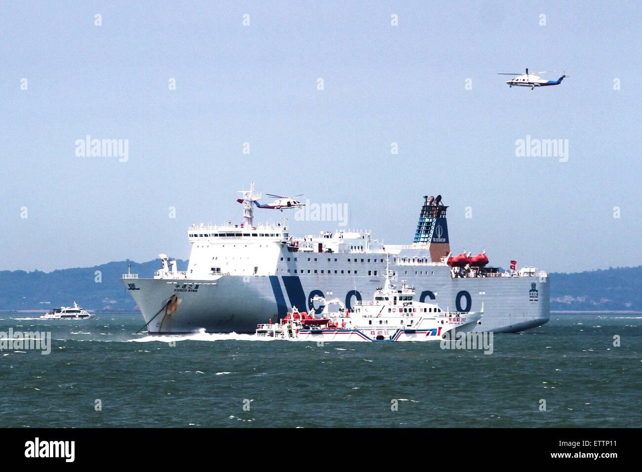 Xiamen, China's Fujian Province. 15th June, 2015. A passenger vessel takes part in a rescue drill in Xiamen, - Stock Image