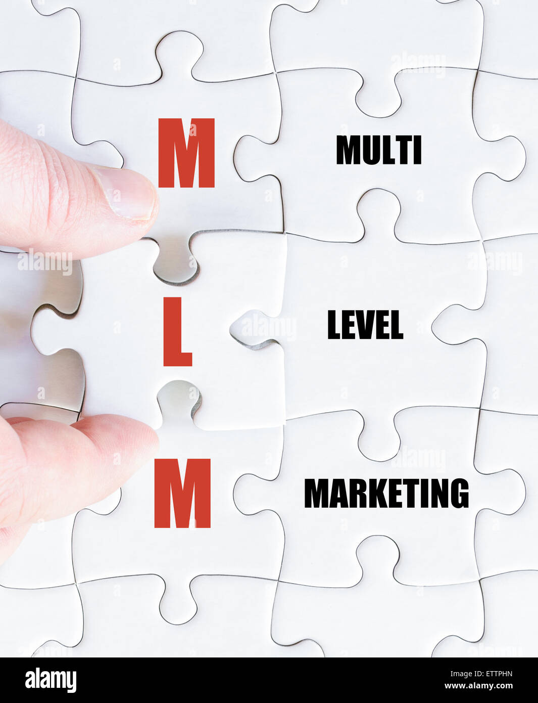Concept image of Business Acronym MLM as Multi Level Marketing Stock Photo