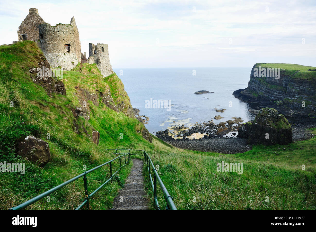 Dunluce Castle is a now-ruined medieval castle in Northern Ireland. County Antrim. United Kingdom, UK - Stock Image