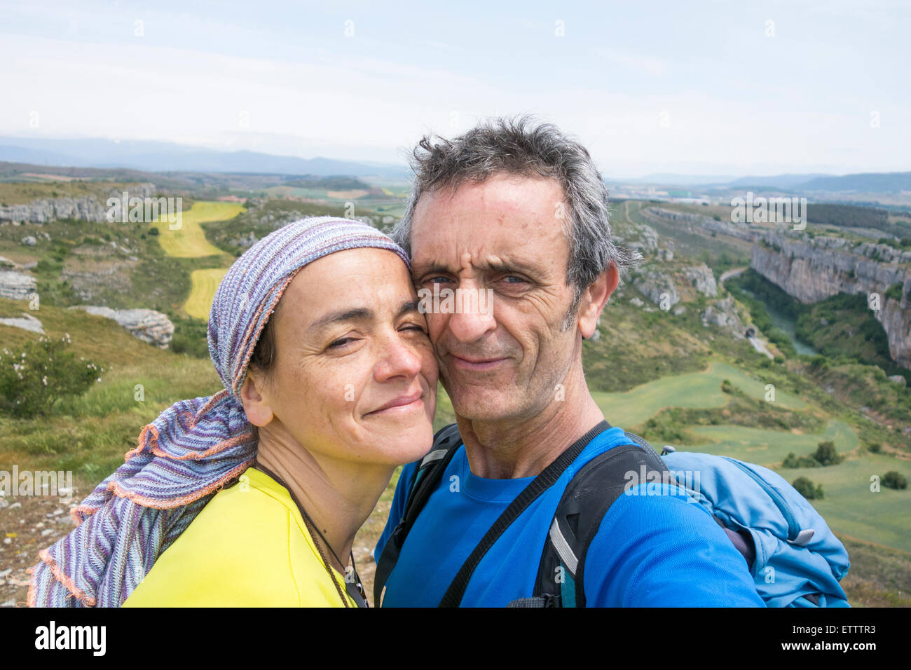 Mature backpacking couple taking selfie. - Stock Image