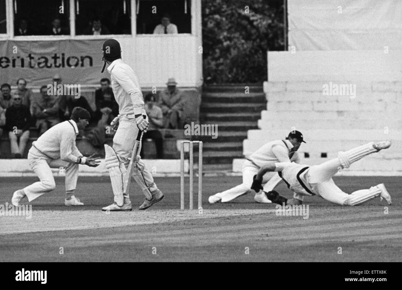 Over and Out. Yorkshire wicketkeeper Steven Rhodes dives to take a spectacular catch in front of first slip Geoff - Stock Image