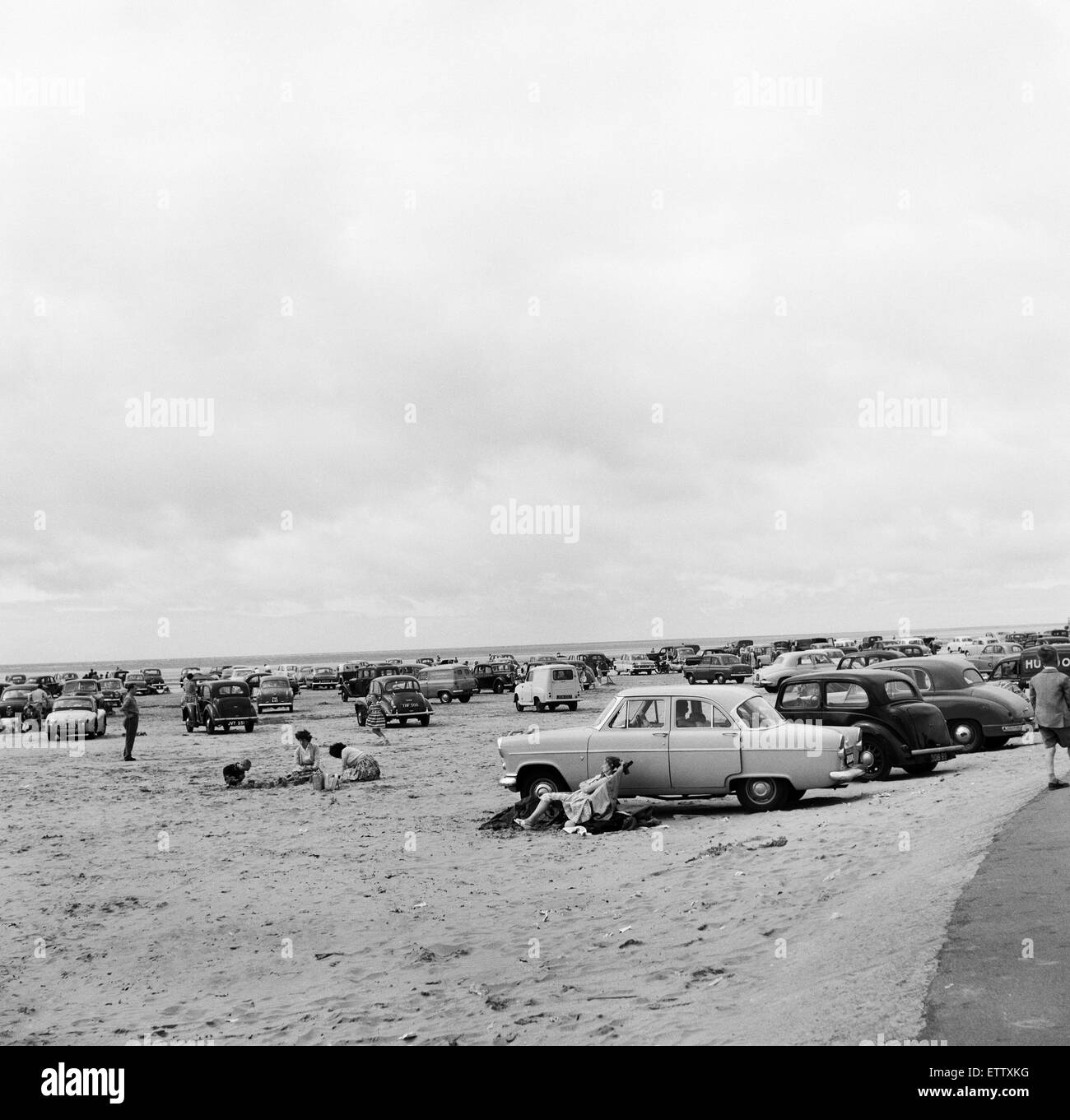 Holiday makers and their cars on Southport beach, Merseyside. 5th August 1959. - Stock Image