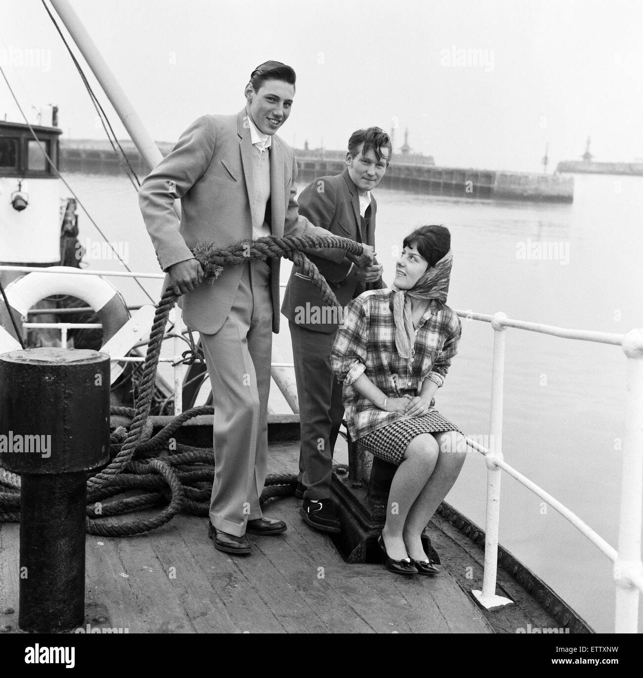 Ray Winney, 16, and Tony Scrivens, 16, with Gloria Knights, 17. on the boat 'Tobago'. 'Dockside Dandies' - Stock Image