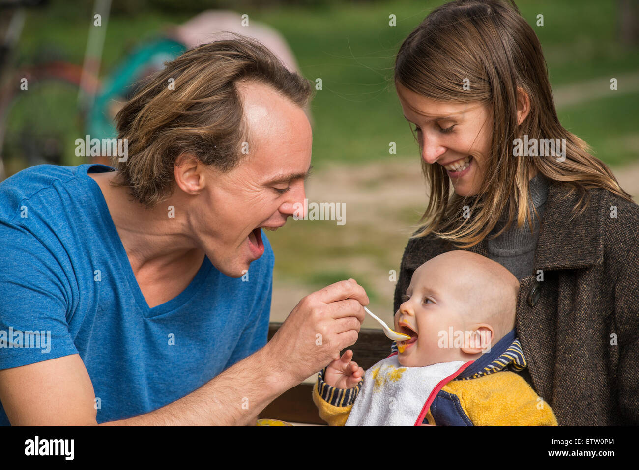 Man feeding his little son - Stock Image
