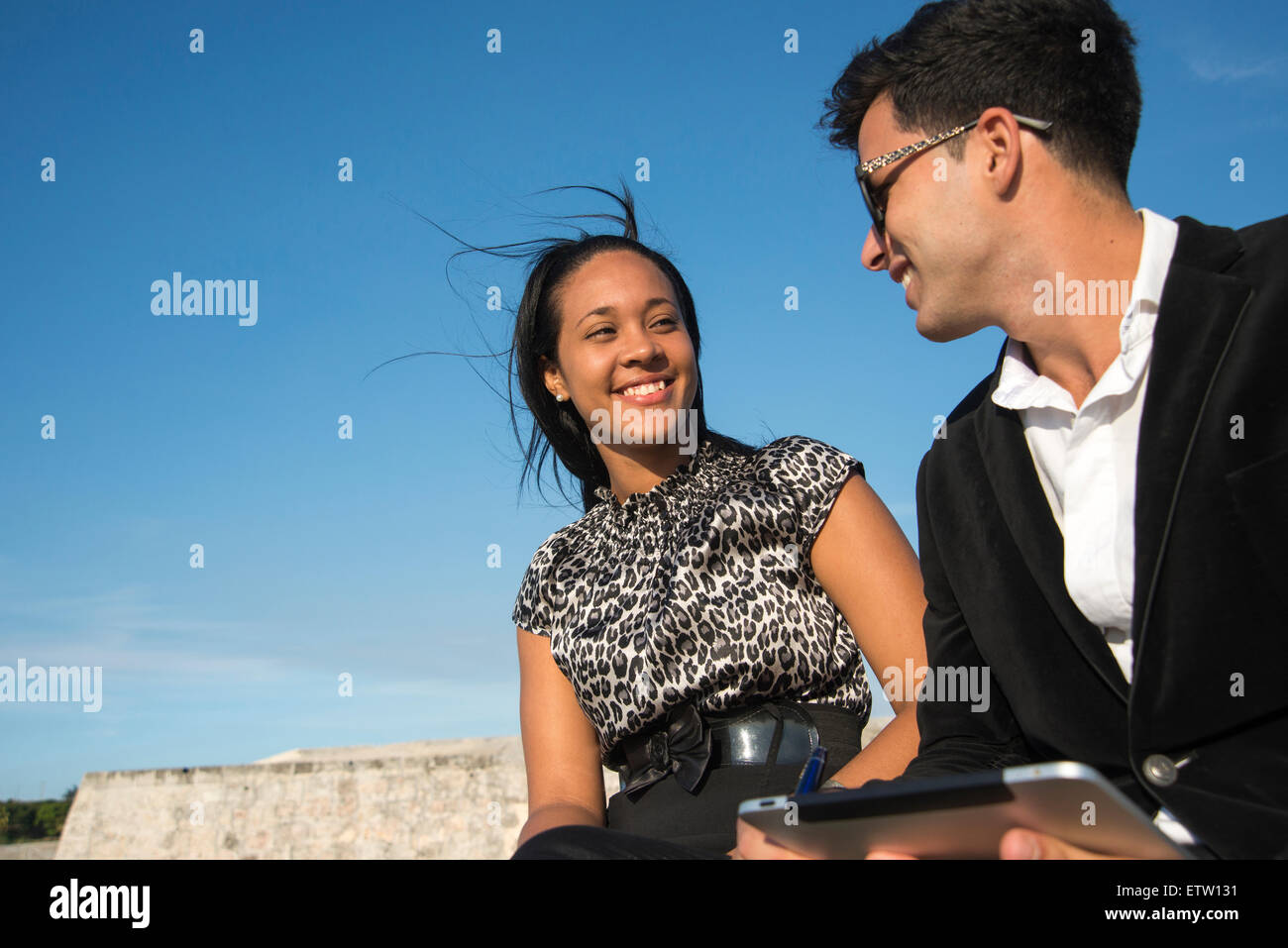 Latin executives with tablet - Stock Image