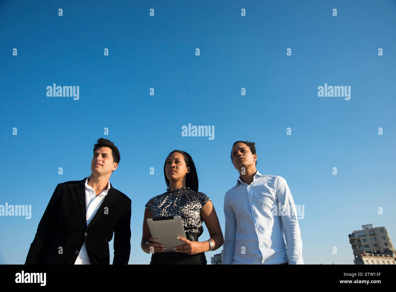 Three Latin executives outdoors - Stock Image