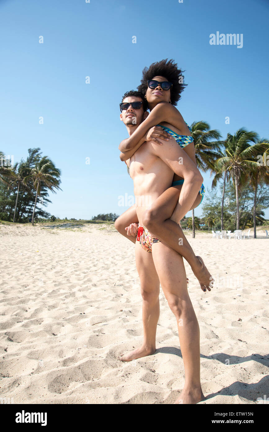 A Latin couple on the beach - Stock Image