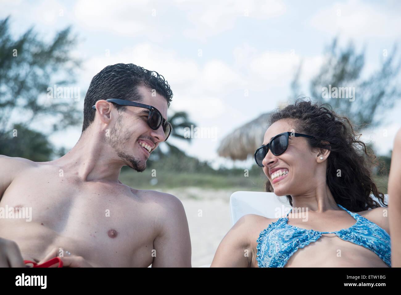 Latin couple on the beach - Stock Image