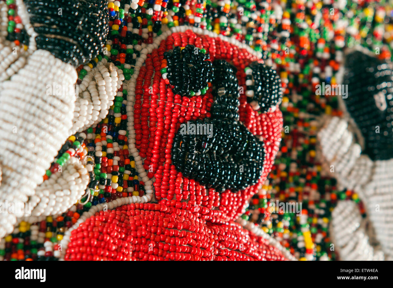 Yoruba tribe three dimensional beaded crocodile diviner's panel from Nigeria in studio setting - Stock Image