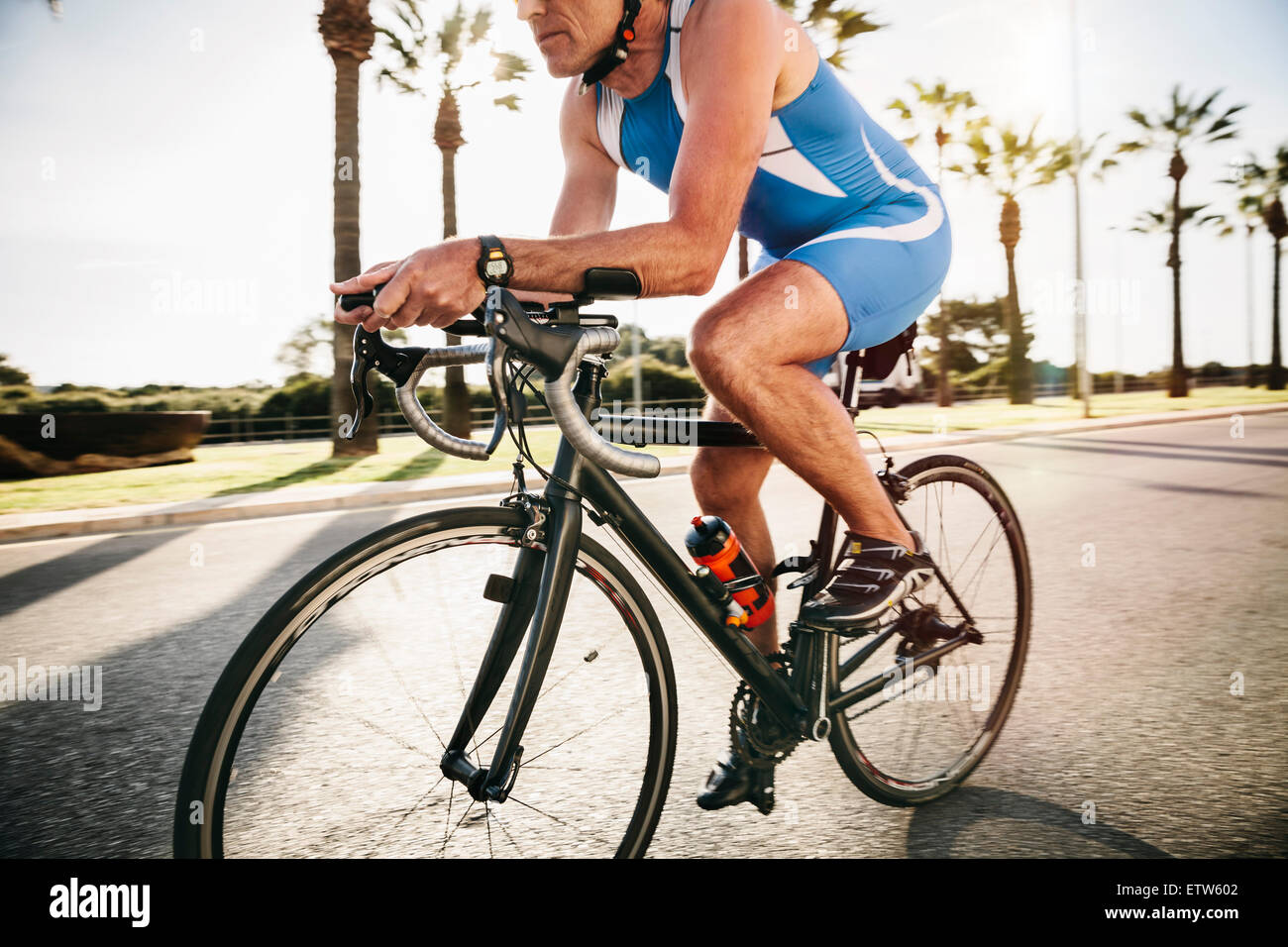 Spain, Mallorca, Sa Coma, triathlet training on bicycle - Stock Image