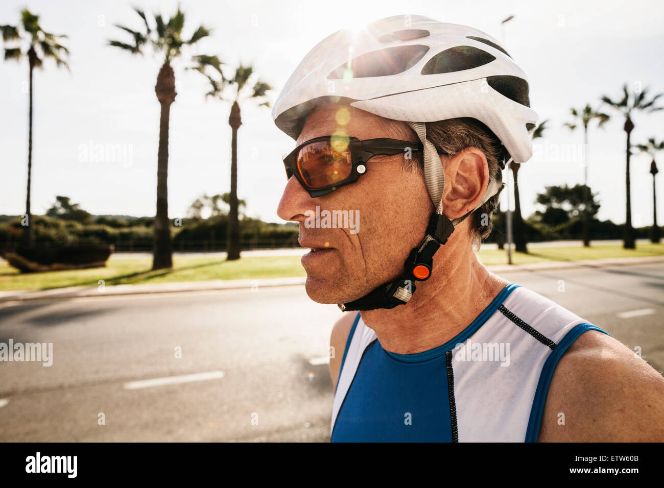 Spain, Mallorca, Sa Coma, portrait of triathlet with cycling helmet - Stock Image