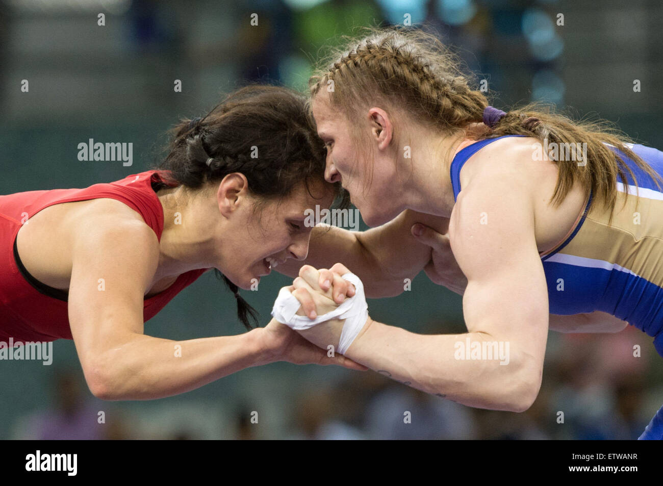Jaqueline Schellin (red) of Germany and Valentina Islamova Brik (blue) of Russia compete in the women's Freestyle - Stock Image