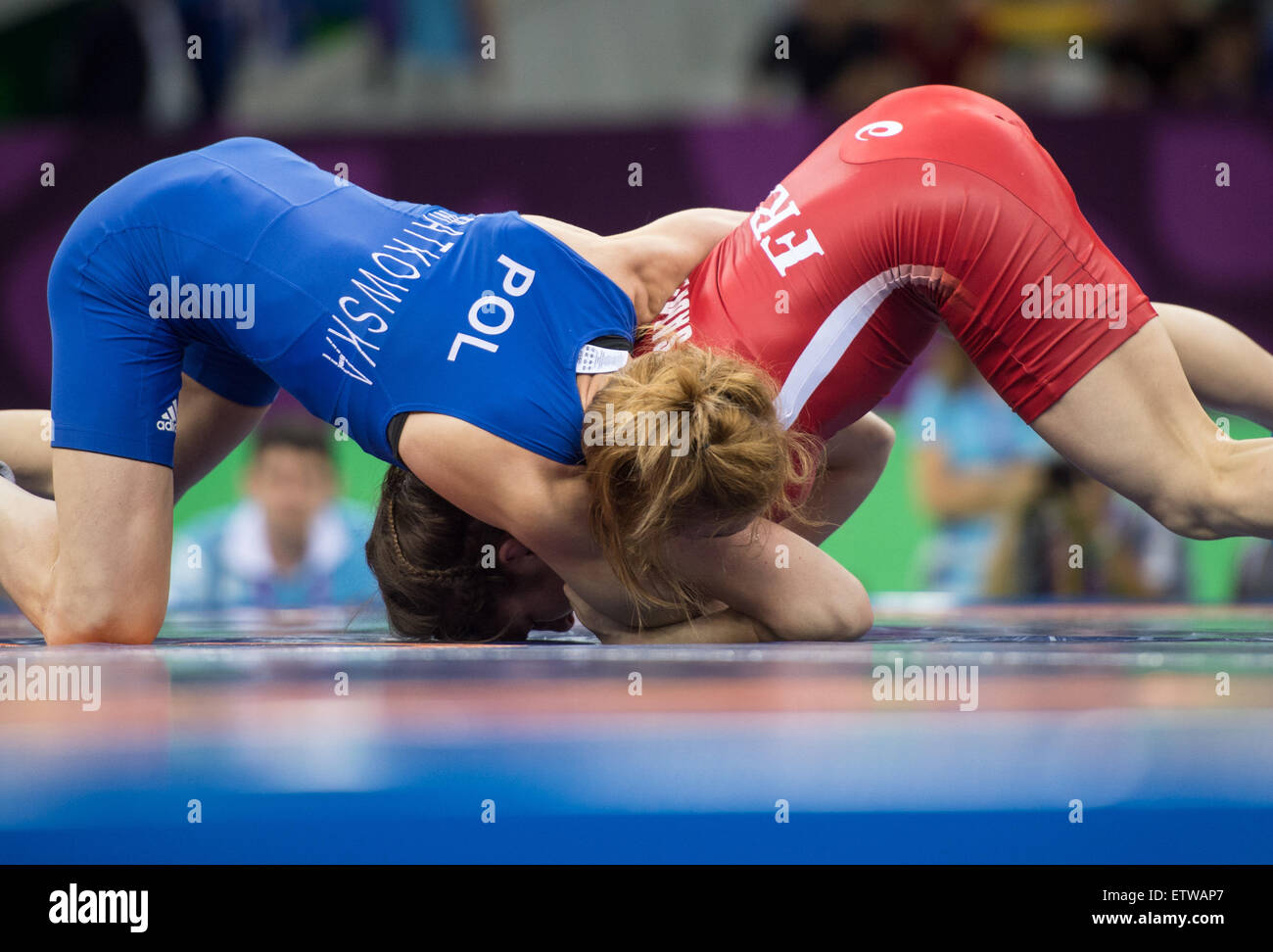 Julie Sabatie (red) of France and Iwona Matkowska (blue) of Poland compete in the women's Freestyle 48kg wrestling - Stock Image