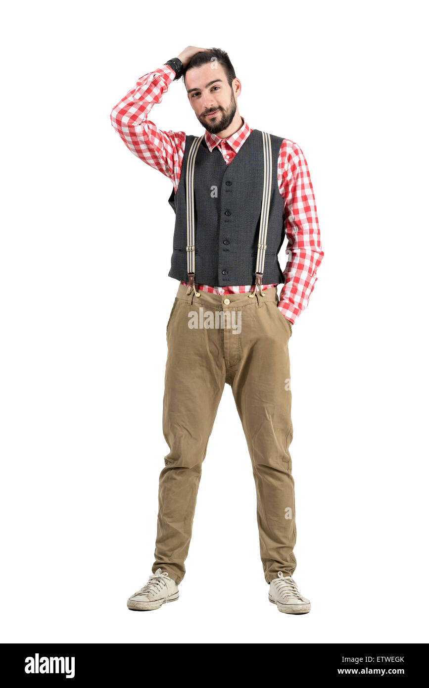 Young bearded hipster with hand through hair. Full body length portrait isolated over white studio background. - Stock Image